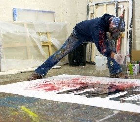 Throwing paint onto canvas