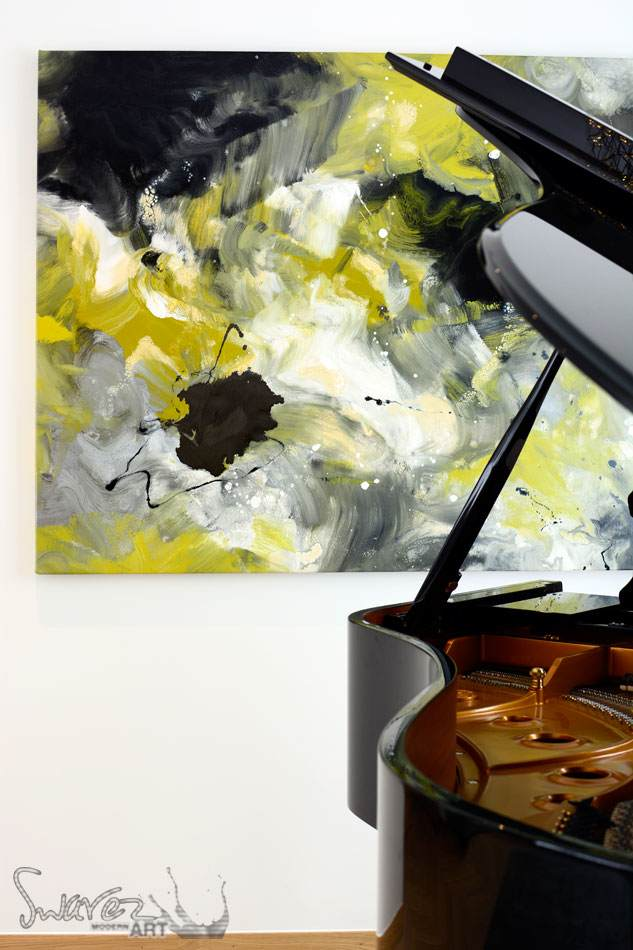 Mustard and silver coloured art with a piano in the foreground