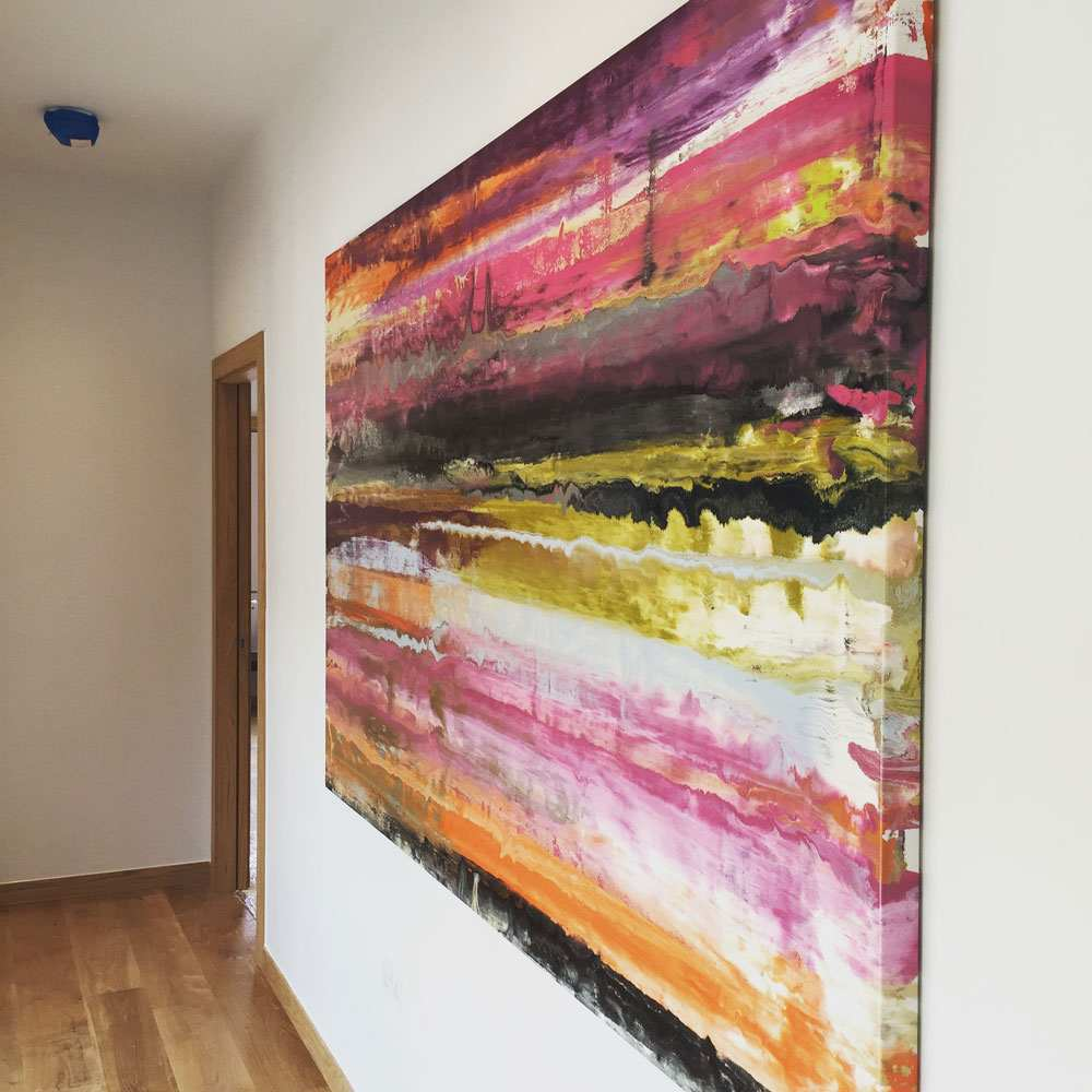 Contemporary art hanging in a large landing space