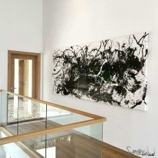 Large black artwork in a gallery landing