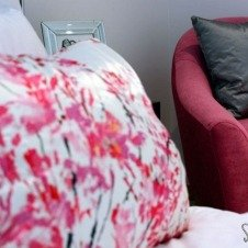 Pink-chair-and-floral-bedlinen