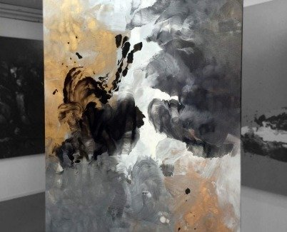 Black silver and gold painting on a stand