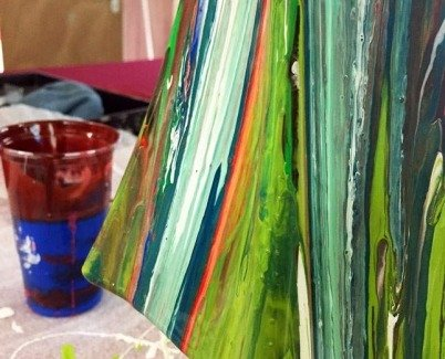 Vase painted in green and blue paints