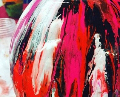 Detailed view of pink and red paint on glass