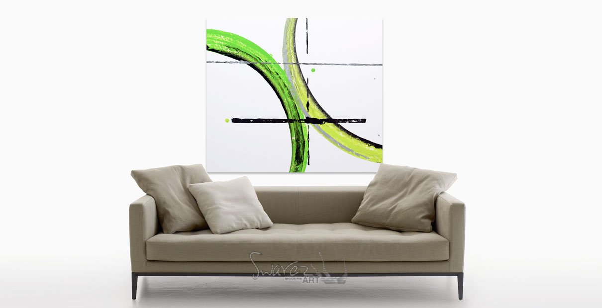 Green art above a sofa