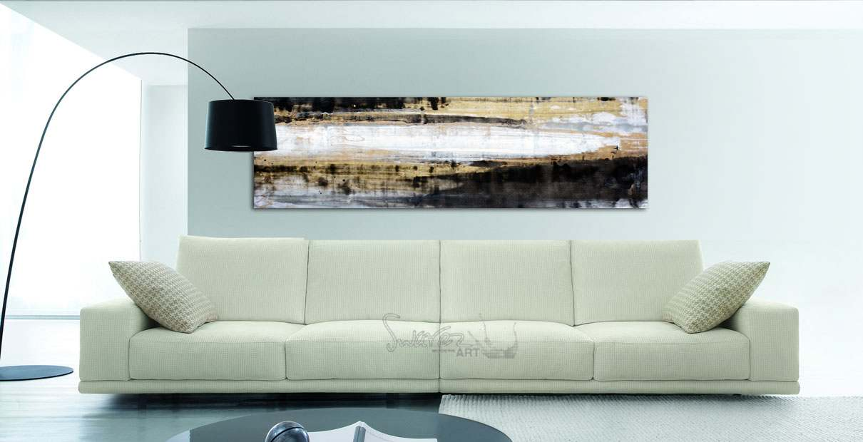 Autumn themed art hanging above a sofa