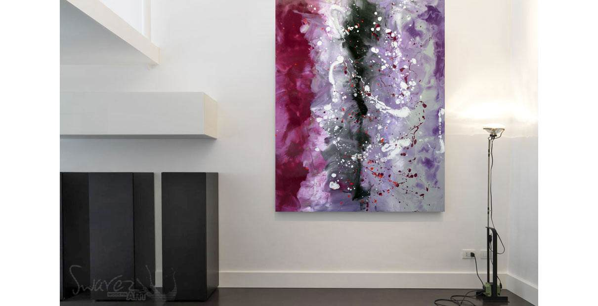 Black and purple art hanging to the left side of a white wall