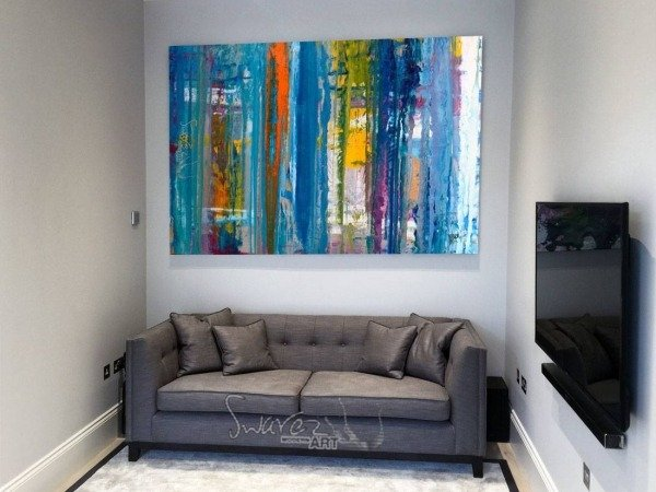 Big-blue-art-above-grey-sofa