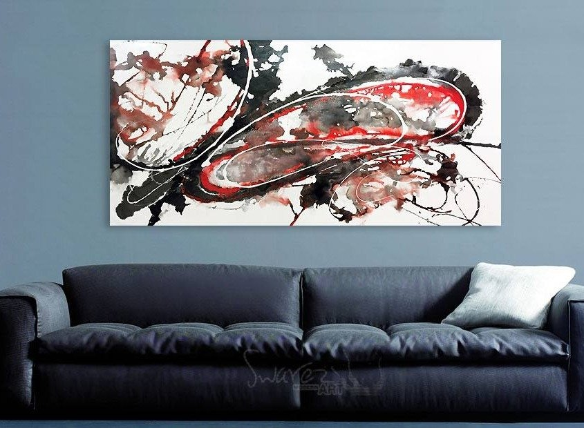 Red and black art hanging on a wall