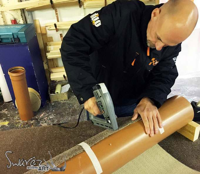 Putting carpet onto a tube