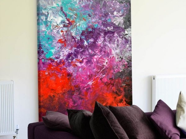 red and turquoise abstract painting in living room