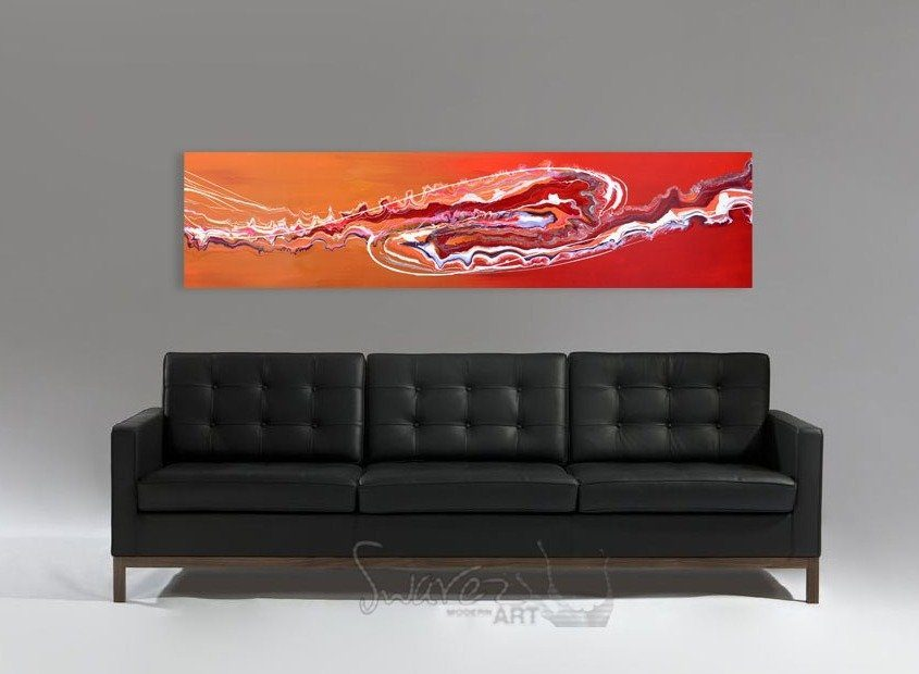 Black leather sofa and red art