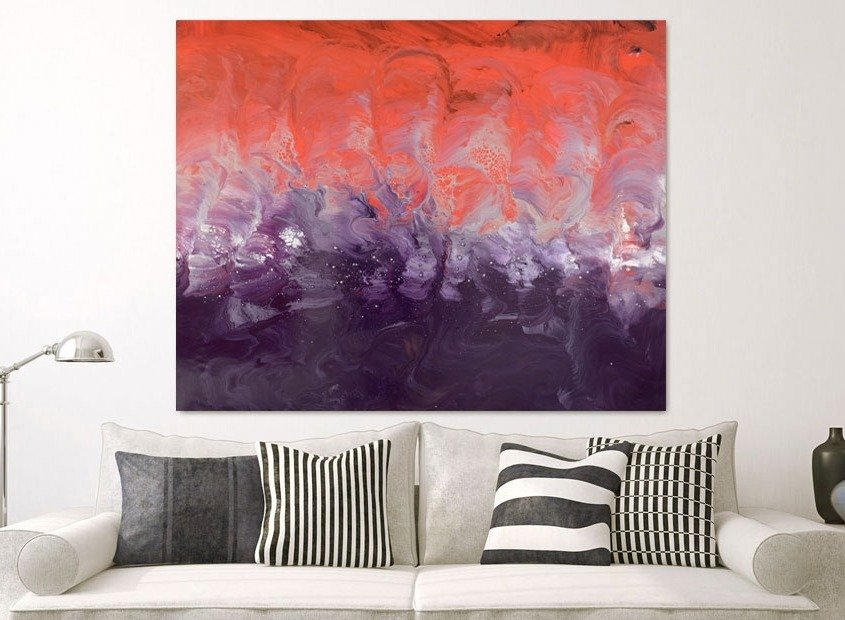 Red and purple painting above a sofa