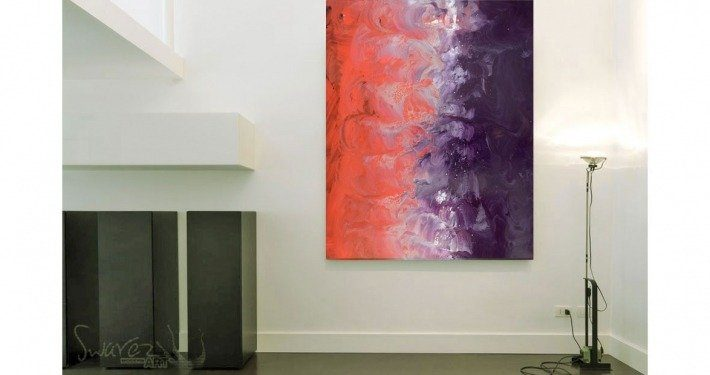 Red and purple art on a wall hung portrait