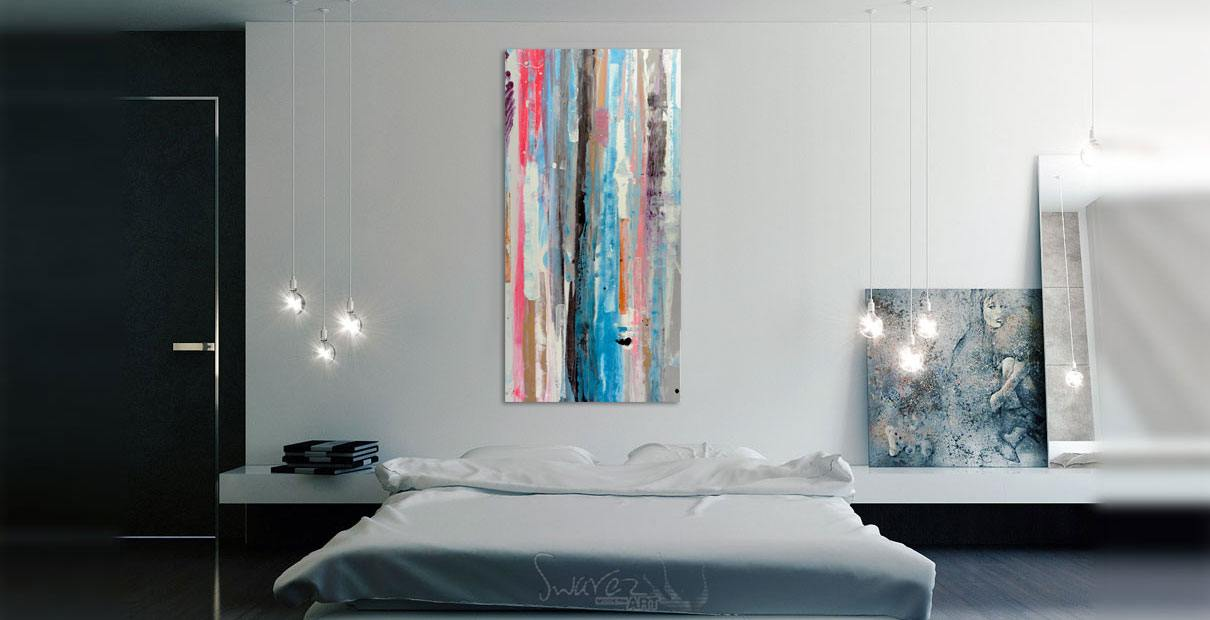 Tall abstract art over a bed