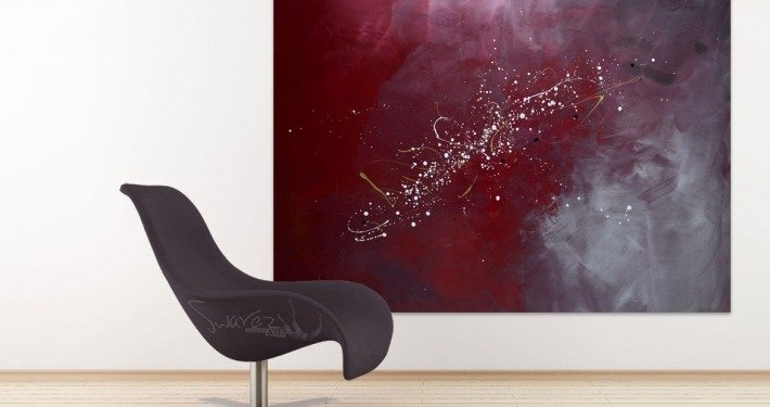 A modern chair and a large contemporary painting