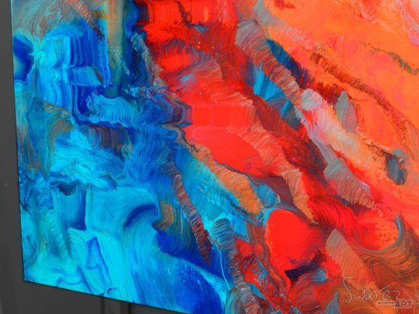 Blue and red paints on a painting