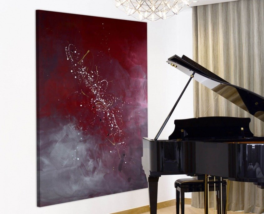 Burgundy art and a grand piano
