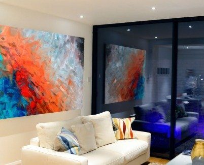 Red and blue art in a modern living room