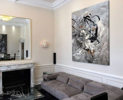 Black and white art hanging in a grand living space