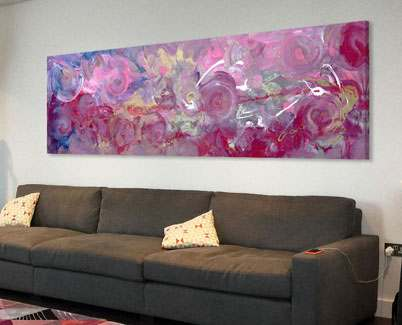 Large-pink-and-gold-painting-above-a-grey-sofa