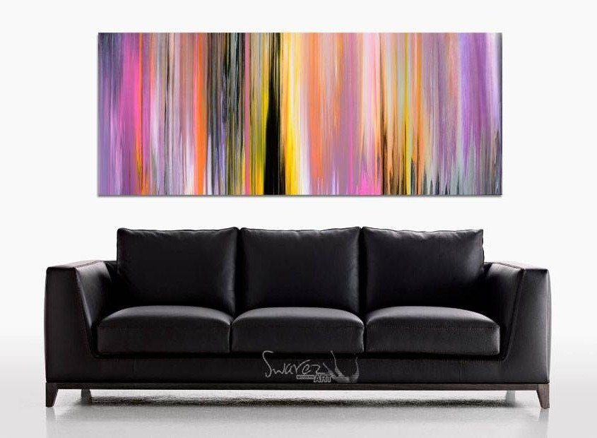 Black leather sofa and art