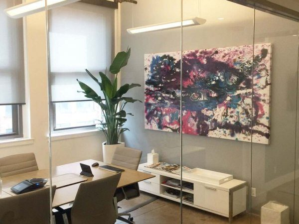 Blue and purple art hanging in a company boardroom