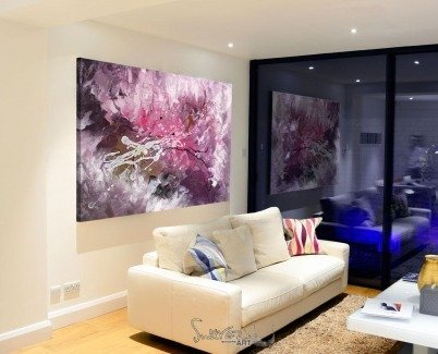Pink and purple paintinghanging above a contemporary sofa
