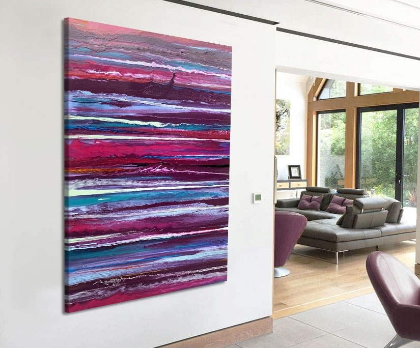 pink and purple abstract art on a wall