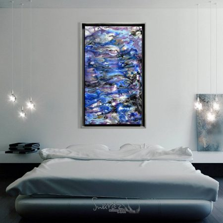 Blue and silver art above a bed