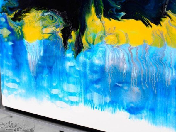 Close up view of a blue and yellow painting