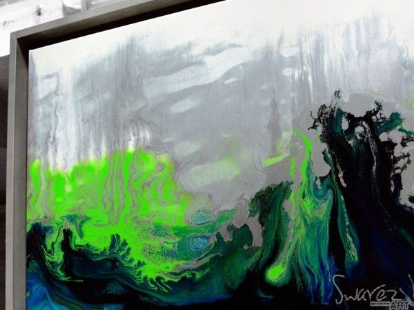 Side angle of green and silver paints on an abstract painting by Swarez