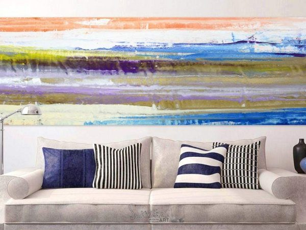 gold and blue art above a sofa