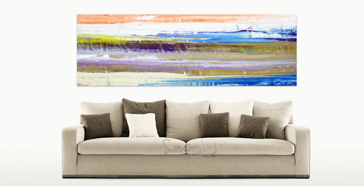 Lined painting hanging above a brown sofa