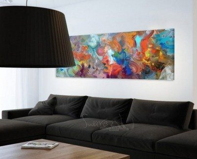 Crystal Waters painting and a large black fabric sofa