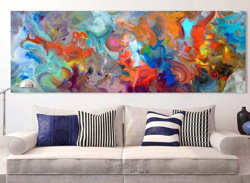 Large colourful painting above a sofa