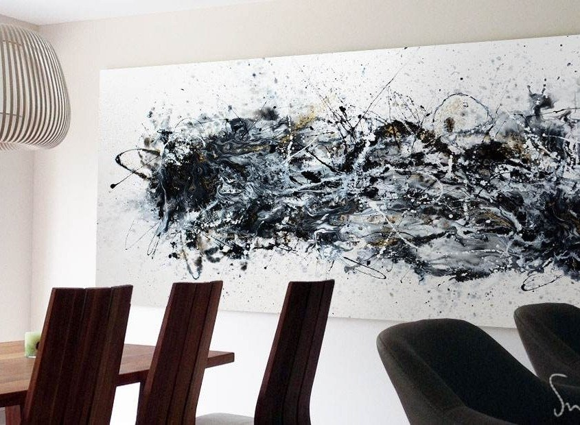 Large monochrome art in an open plan living space