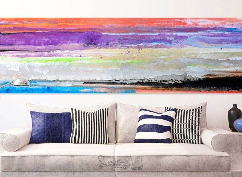 Striped art above a sofa