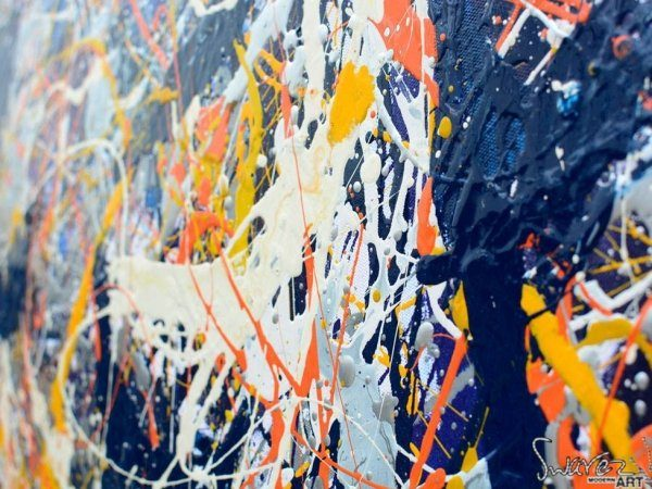 Close up of an orange and blue drip painting