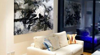 Black and white contemporary art in a modern living room