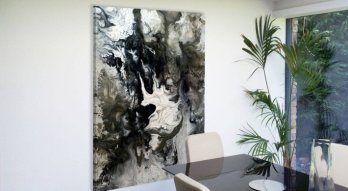 Large monochrome painting in a dining room