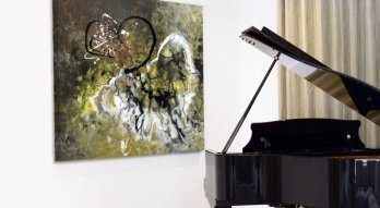 grand-piano-with-art-behind-it