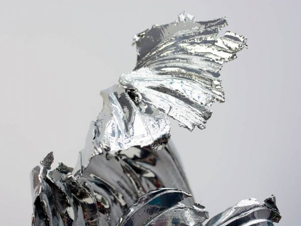 details of the top of a modern chrome sculpture