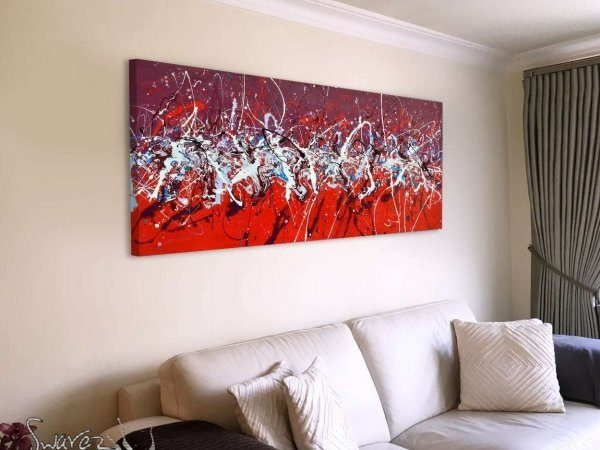 red and purple painting above a cream sofa