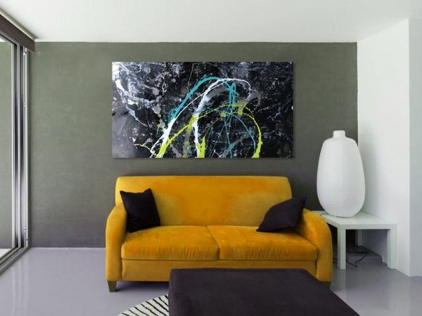 Orange sofa and abstract art above