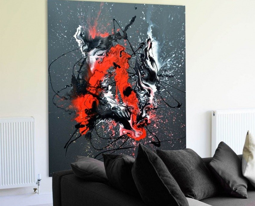 Tall black canvas behind a sofa