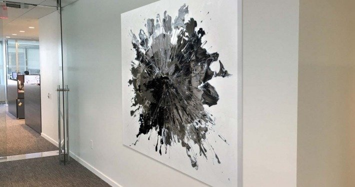 Black and white art called Time hanging in a corridor