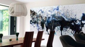 Large blue and black art in a dining room