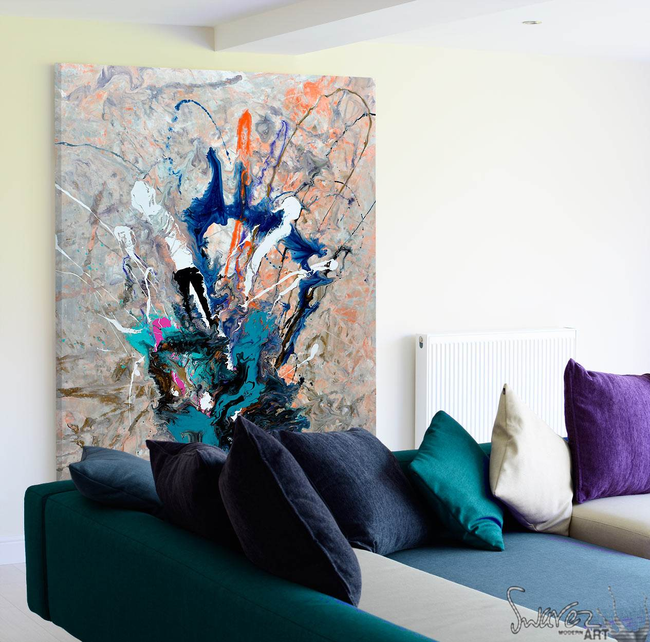 abstract painting behind a sofa