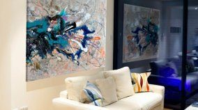 abstract painting in a modern lounge